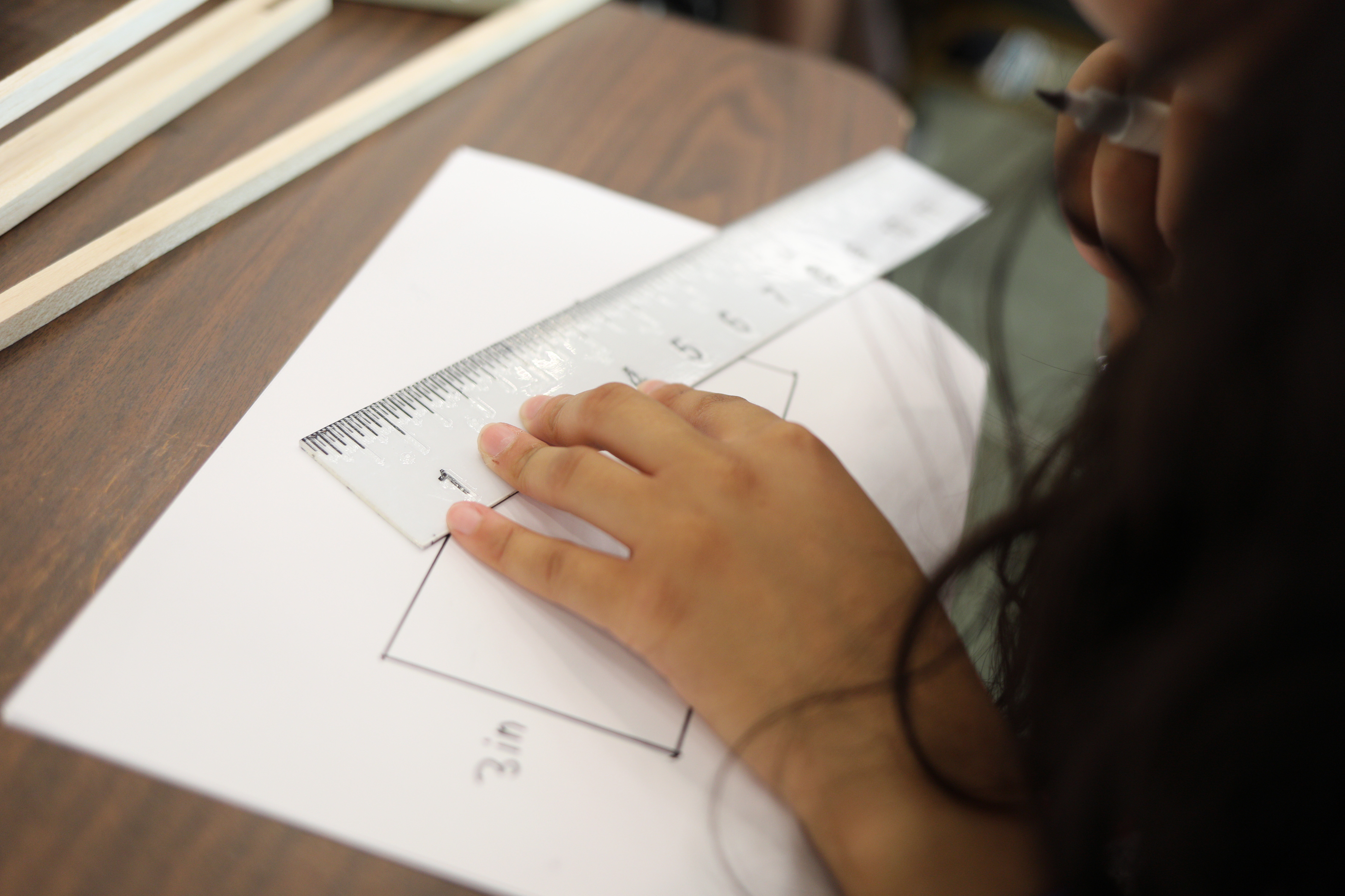 Photo of a student measuring angles using a Braille ruler.