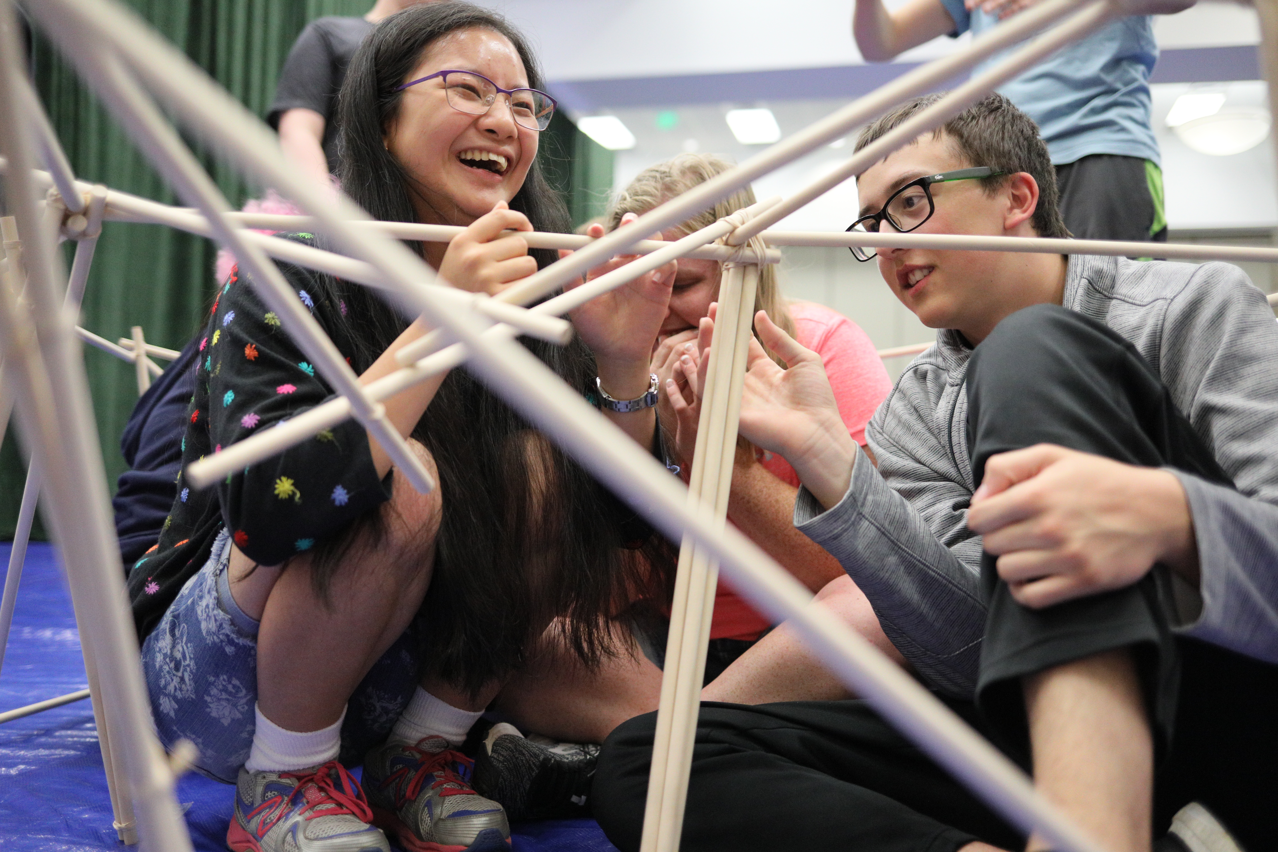 Photo of students working together building a structure