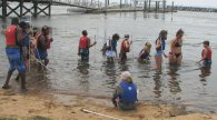 JSA students wade in the Chesapeake Bay looking for clams.