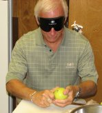 John Butler peels an apple under sleepshades.